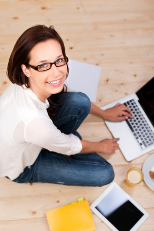 Top view shot of woman studying with laptop on the floor Stock Photo - 21149032