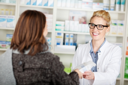 Female customer buying medicine at the pharmacy photo