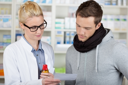 Young male customer buying medicine at the pharmacy photo