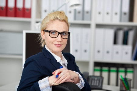 Portrait of a confident and beautiful young businesswoman wearing glasses at work Stock Photo - 21149386