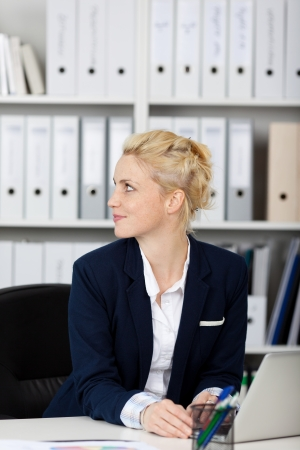 Side view on blond and beautiful young businesswoman at work photo