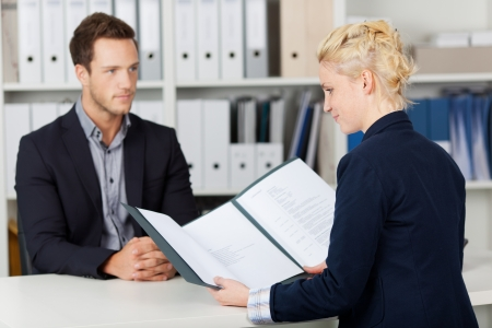 Recruiter and male candidate during a job interview photo