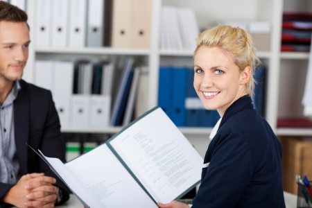 job qualifications: Smiling female recruiter and male candidate during a job interview