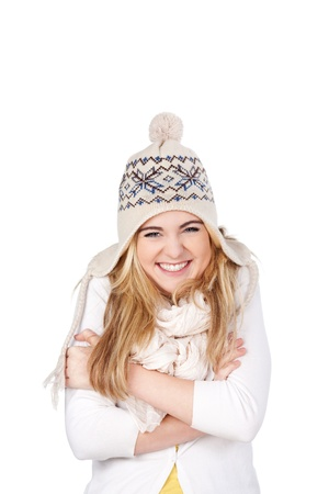 Portrait of a smiling teenage girl in winter clothing standing against white background photo
