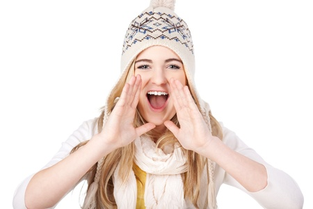 Image of a happy teenage girl shouting wearing warm clothes, isolated on white background. photo
