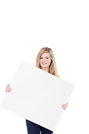 Image of a happy teenage girl holding a blank sign board, isolated on white background. photo