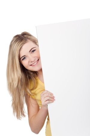 Image of a cute teenage girl holding a blank board, isolated on white background. photo