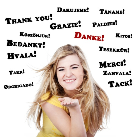 Portrait of a happy and thankful teenage girl against white background Stock Photo - 21190306