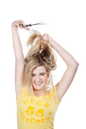 Image of a teenage girl cutting her hair by herself, isolated on white background. photo