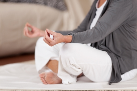 meditation room: Closeup photo of a female meditating to find inner peace. Stock Photo