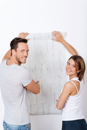 home decorating: Young couple is looking for a new wallpaper