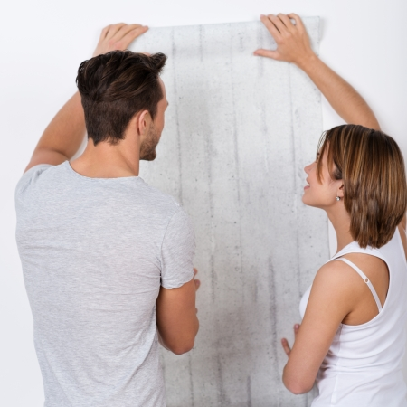 Young couple is choosing a new wallpaper photo
