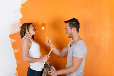 redecorating: Young couple is having fun redecorating and painting