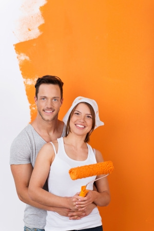 redecorating: Couple in love while redecorating and painting their appartment Stock Photo