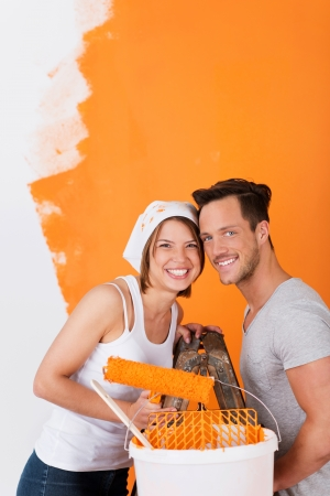 Happy couple having fun painting their appartment photo