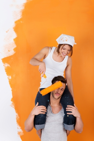 Couple is having fun redecorating their new appartment photo