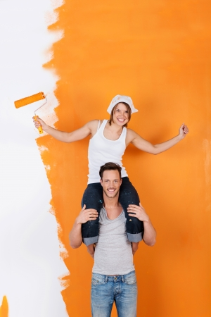 redecorating: Couple is havin fun redecorating their new flat