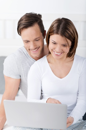 Couple in love looking together at laptop screen photo