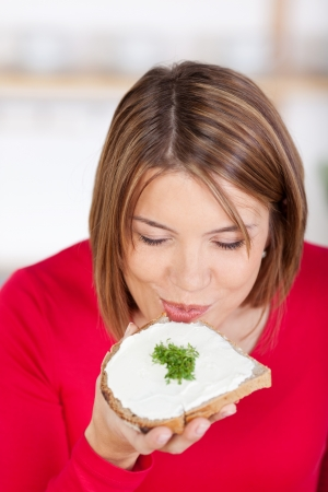 eaten: Healthy bread with cress for breakfast eaten by a pretty girl