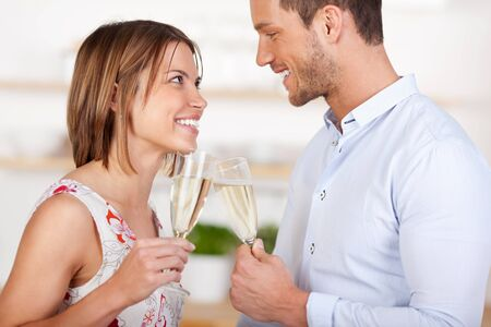 Young in love couple dating with champagne in a close up shot photo