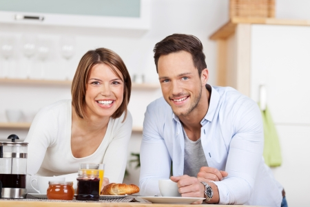 Portrait of sweet couple having a breakfast in the kitchen photo