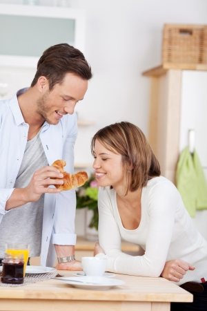 In love young couple eating breakfast in the kitchen photo