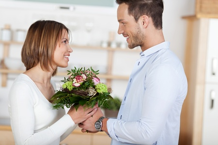 gets: Happy girl gets beautiful flowers from her boyfriend Stock Photo