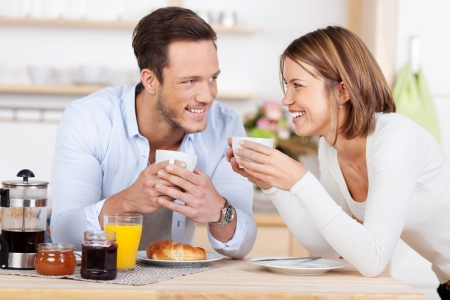 Getting ready for the day with a morning coffee and breakfast Stock Photo
