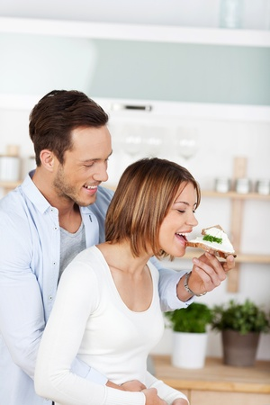 Cheerful couple eating at home in their kitchen Stock Photo - 21162502