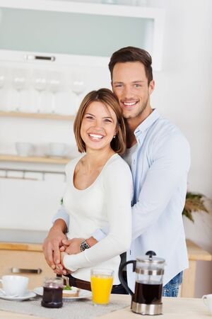 Cheerful is couple preparing breakfast at home photo