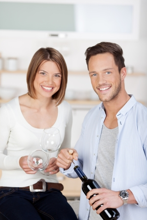 Romantic couple drinking red wine at home photo