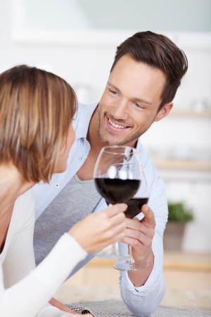 cheers: Romantic couple dating and cheers with red wine