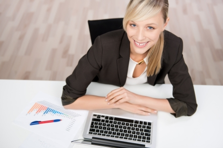 top angle: Successful businesswoman working in front of her laptop