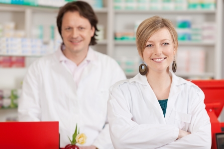 female and male co workers in a pharmacy photo