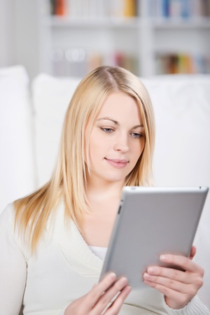 Closeup of young woman using digital tablet in house Stock Photo - 21167100