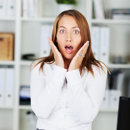 formals: Portrait of shocked businesswoman in formals at office Stock Photo
