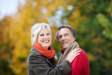 happy retirement: A Senior Couple Posing in the garden Stock Photo