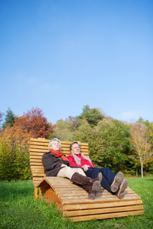 Senior Couple relaxing in the park and enjoying the sun photo