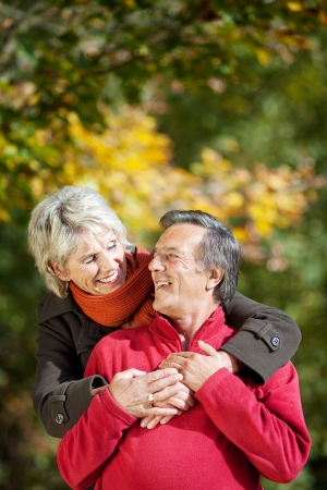 A senior couple enjoying the moment of love in a park photo