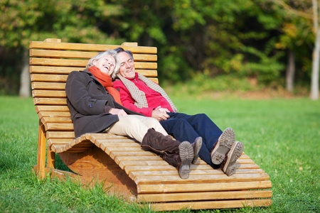 contented: A senior couple enjoying a funny moment in a park