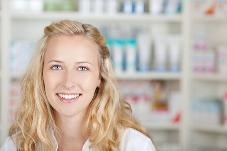 Portrait of a female pharmacist at pharmacy smiling photo