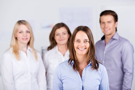 Portrait of confident businesspeople standing at office photo