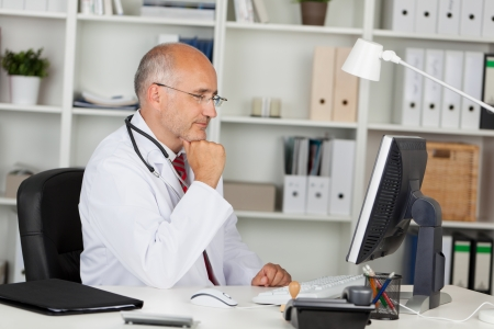 doctor laptop: doctor working with computer in office Stock Photo