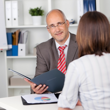 business interview: businessman and female candidate in personal interview Stock Photo