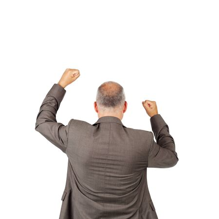 Rear view of mature businessman with arms raised celebrating victory isolated over white background photo