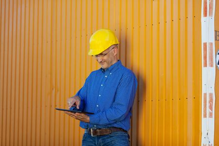 btp: Portrait of confident male architect working with digital tablet Stock Photo