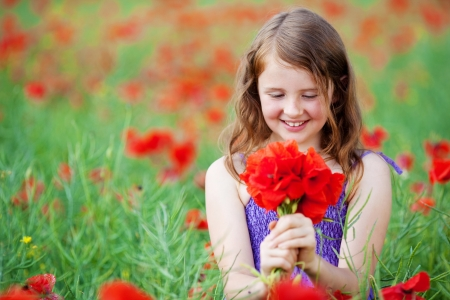 Happy young female holding a bunch of flower in field Stock Photo - 21195332