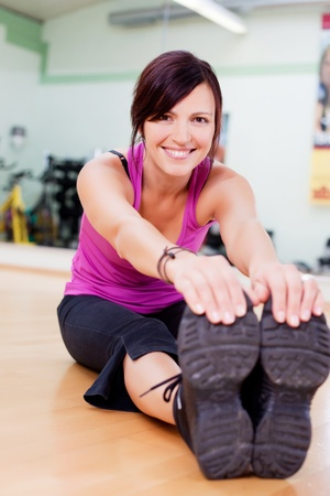 touching toes: Fit and healthy woman stretching touching toes Stock Photo