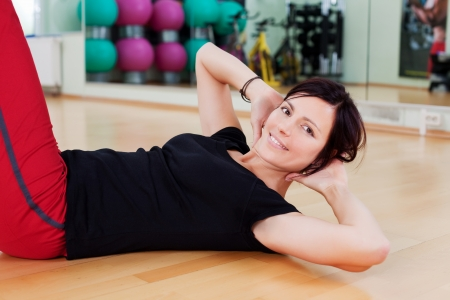 situps: Portrait of fitness woman exercising her abdominal muscle