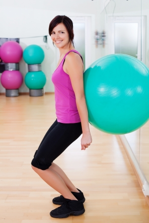 fit ball: Woman dressed sportswear exercising making a fitball squat